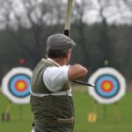 Sports archer preparing to fire